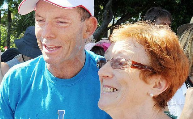 Tony Abbott with Carmel Smyth at Torquay Beach after he completing to the 1.6 km Beach to Club ocean swim.