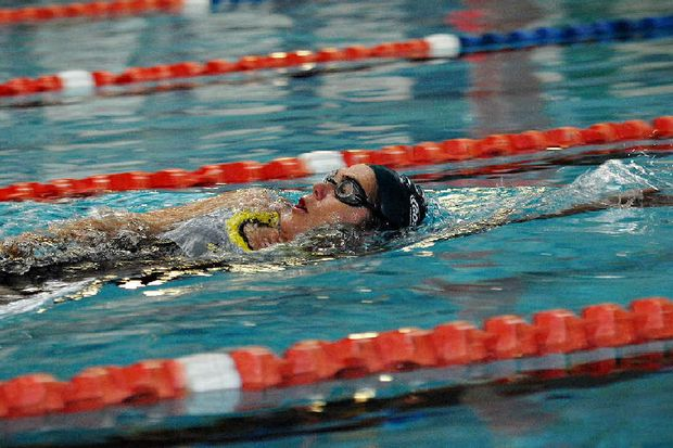 Angela Malone hits the water at the Pat Wright Swim Centre for an early training session. The centre, which has a 25-metre lap pool, has been opened for an extra two hours on Sundays.