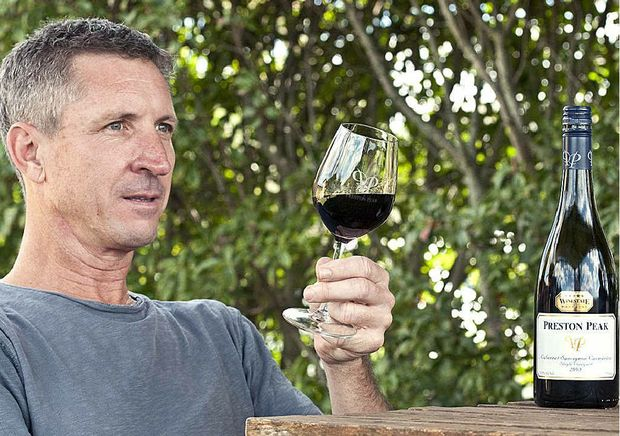 Preston Peak Winery owner Ashley Smith tastes his award-winning 2008 cabernet sauvignon carmenere. He expects the 2012 vintage to taste even better.
