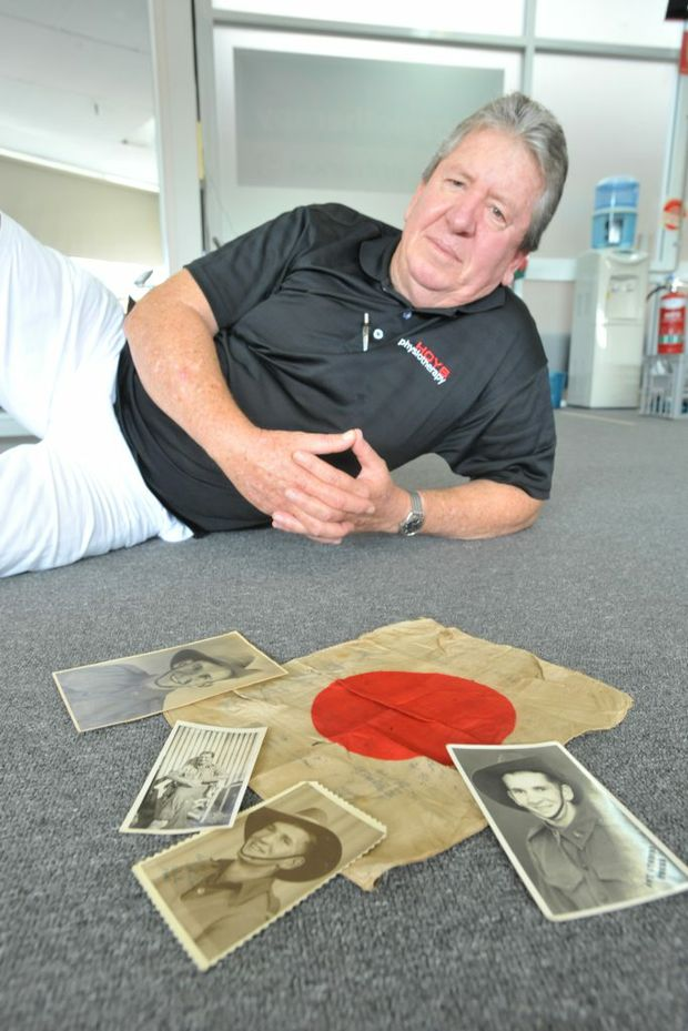 Garry Heskett has a Japanese good luck flag that his father gained in a balttle in PNG in WW2. Photo: Rob Wright/ Coffs Coast Advocate