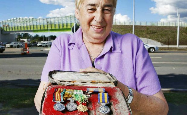 Goodna RSL Sub-branch president Vivienne Stanbury with medals discovered at the motorway upgrade site in Dinmore.