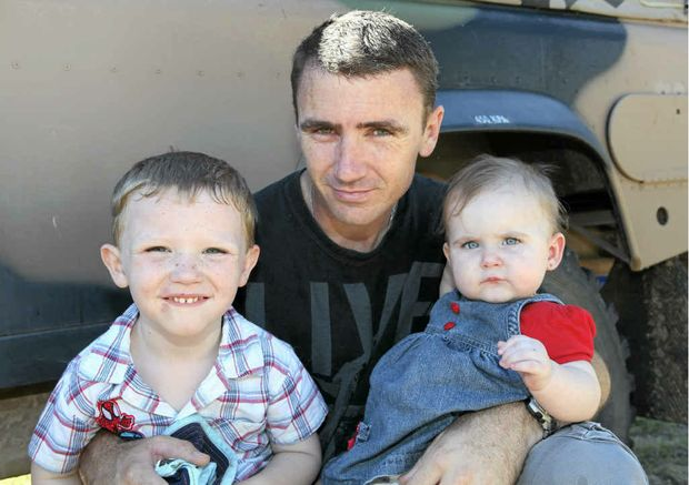Cade (4) and Laylah (10 months) are glad to have their dad, Gavin McMillan, back after he spent seven months away on deployment with the Army Reserves.