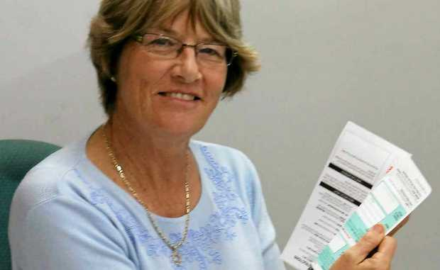 Assistant returning officer Margaret Adcock reminds voters to not remove the flap containing their signature and witness details on the return envelope.