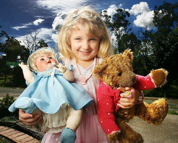 Five-year-old Brooke Boetje takes a look at what's going on show at the Ipswich Gala Doll Fair at the Civic Centre on April 29.