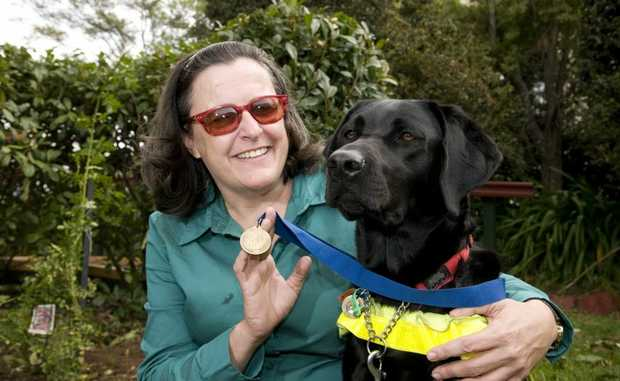 Danae Sweetapple and her guide dog Olive who recently graduated from her training.