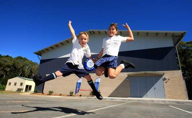 Isaac Gorton, 5, and Elke Borgas, 10, jump for joy at the opening of the new hall at Pacific Coast Christian school.
