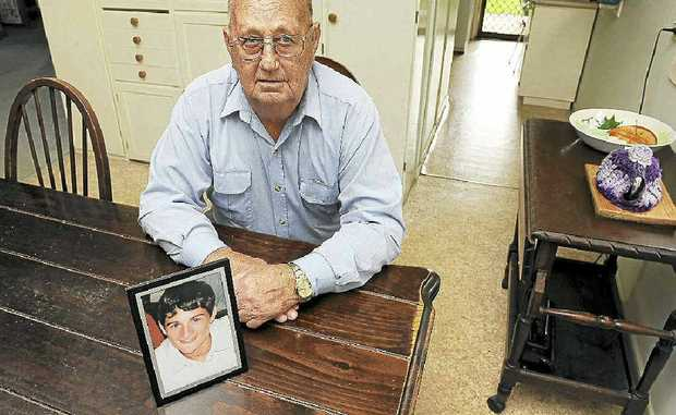 Pat McGrath with a photo of his grandson Bryce Wells who died in a car accident in 2006.
