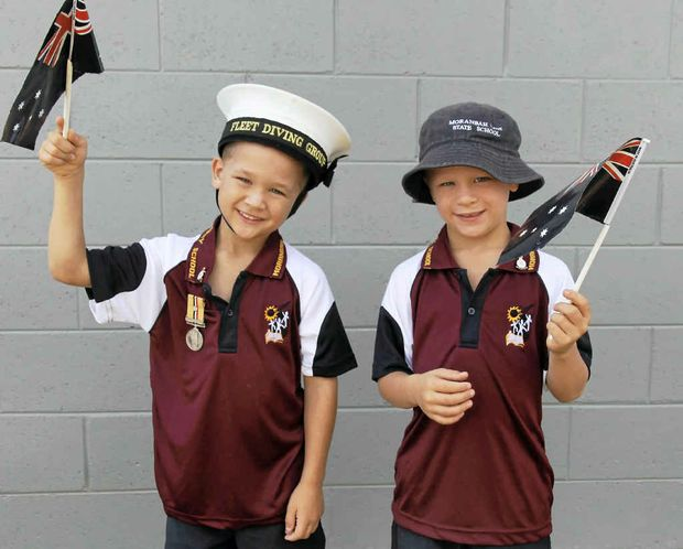 Ethan (left) and Hayden Cummings at Moranbah's march.