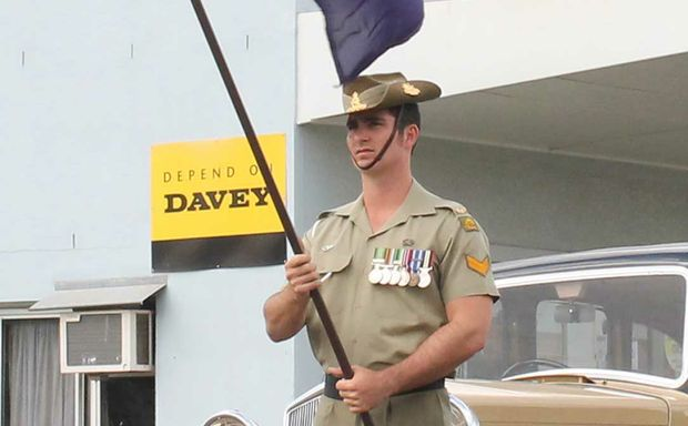 HONOURED: Former Proserpine resident Bombardier Herbert Larsen-Bayer took part in his first ANZAC Day ceremony in his home town and lead the Proserpine procession holding the Australian flag