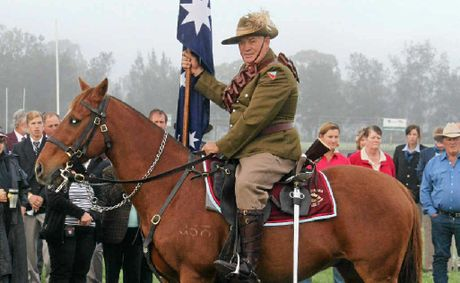 Peter Hatton, mounted on his trusty steed, at the Polocrosse Nationals Anzac memorial service.