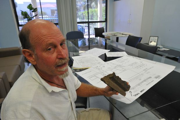 George Oxenbridge shows off a cross section of the Grafton Bridge top deck and plans of the bridge.