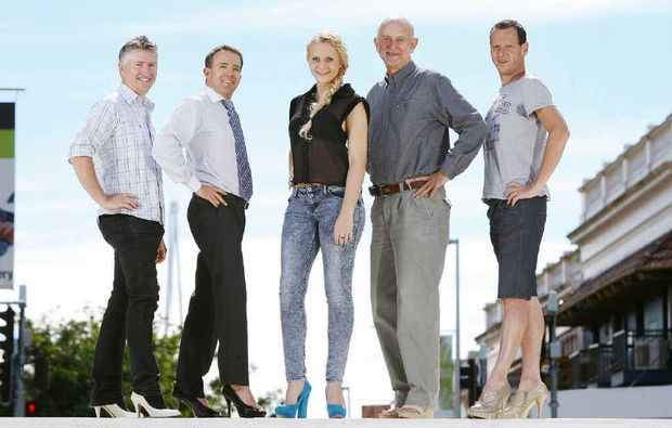 Pictured from left, Jason McNamara of Direct Sauce Media, Steve Portas of The Queensland Times, Ashleigh Knight of Obsession Shoes, Bruce Hansen of Relationships Australia, and Craig Felmingham are ready to Walk a Mile in Her Shoes.