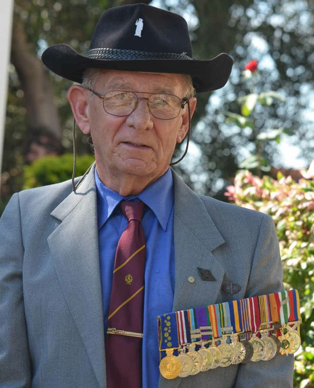 Roy Savage stands proud with his medals on his chest.
