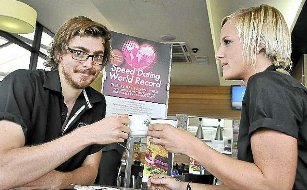 Coffee Club Coolum Beach baristas Stephen Minter and Jess Mercer bean-up in preparation for a speed dating world record attempt at cafes across Australia on Tuesday.