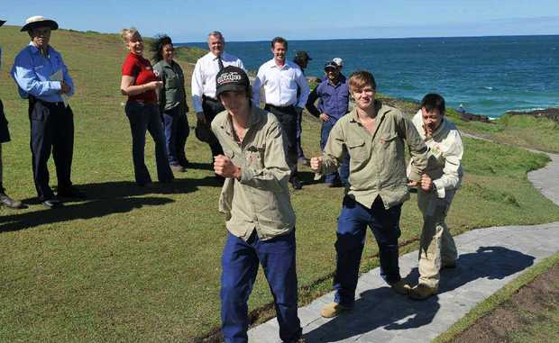 Jacob Clarke (left) and Miles Guthrie-Hanson (centre) are joined by their National Green Jobs Corp supervisor Marcello De Nardis on the project they completed at Bonville Headland.
