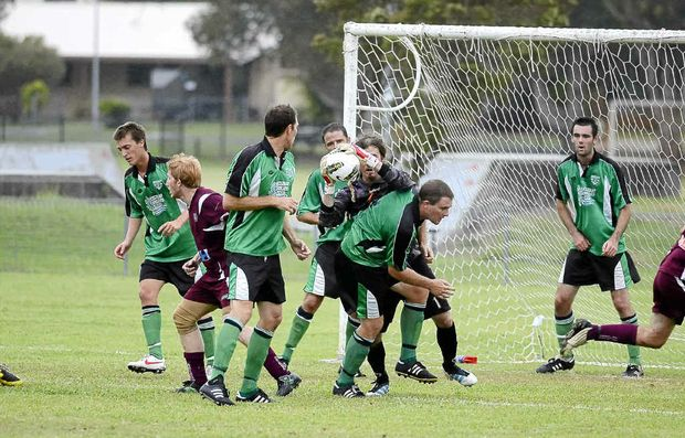 Bobcats goalie Graham Courte snares the ball against Urunga.