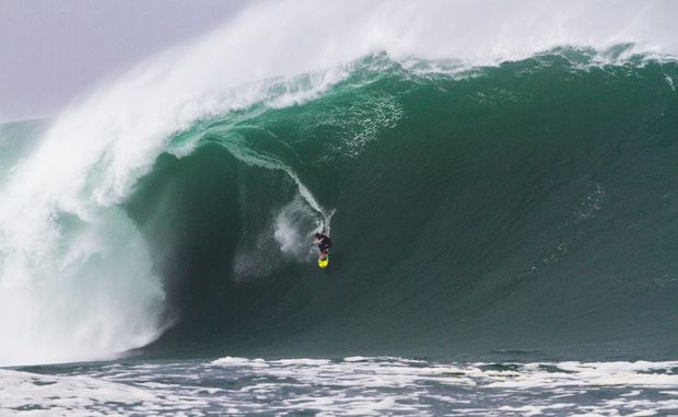 Andrew Cotton (UK) rides a massive wall at Mullaghmore Head, Ireland on March 8, becoming a last-minute contender in the 2012 Billabong XXL Big Wave Awards.