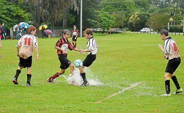 It was more like water polo than football when Alstonville and Rovers met in this Grade 12 clash at Geoff Watt Field on Saturday in one of the only games to proceed because of the weather.