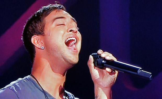 Chris Sebastian has won his battle round on The Voice.