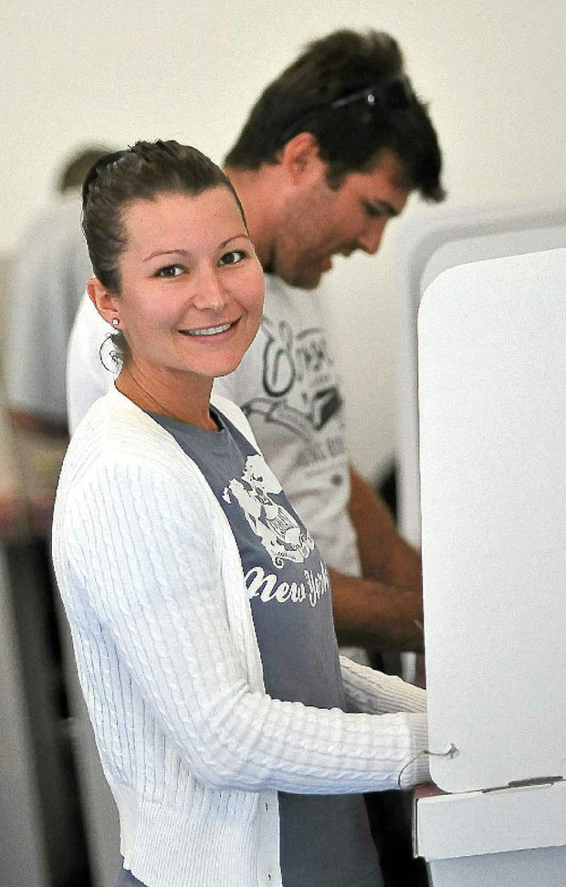 Candice Levey casts her vote at Woongarra State School. Thousands in Bundaberg didn't even turn up.