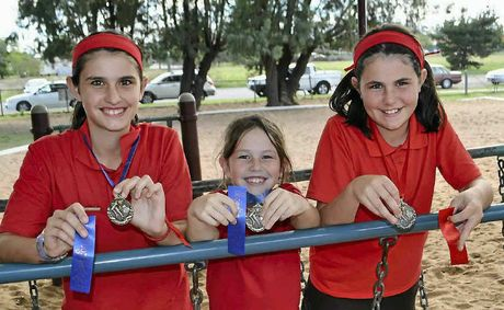 Sisters Ashleigh, 13, Maddie, 9, and Rebekah, 12 cleaned up in the prize pool at the Warwick East State School cross country.