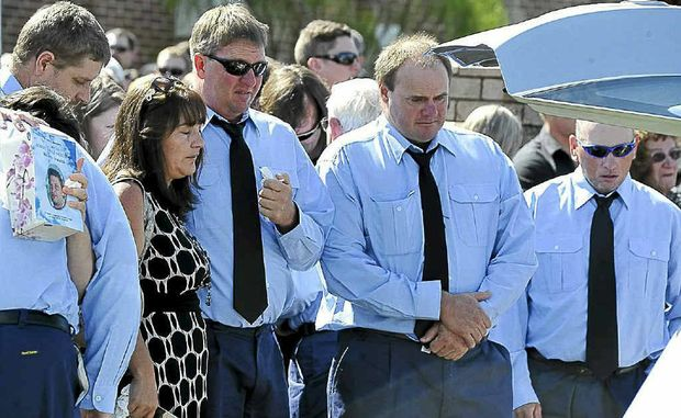 Friends and family farewell Warren and Robert.