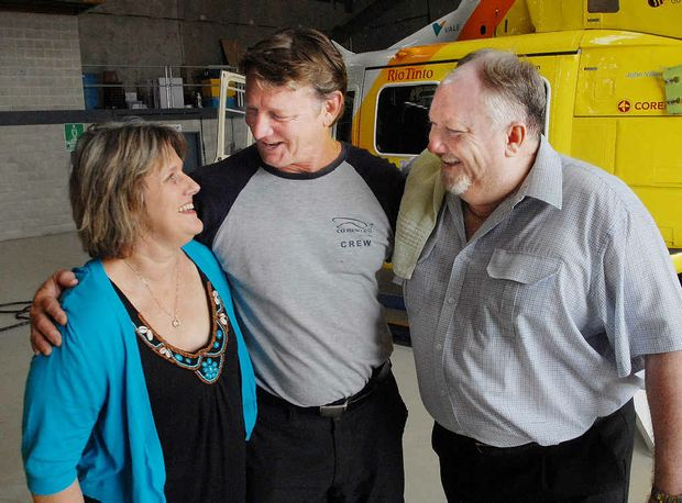 Vicki and Tony Wilson, who were involved in a fatal crash near Carmila on May 2 last year, express their gratitude to RACQ-CQ Rescue pilot Brendon Barron, who represented the service as the couple handed over a $10,000 thank you donation. The pilot on the day was Alex Crawford.