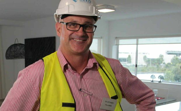 Reed Property Group project director Ross Webb shows off one of the Emporio apartments.