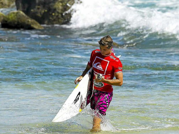Coolum surfer Julian Wilson trudges back to shore at Trestles after causing interference in his heat.