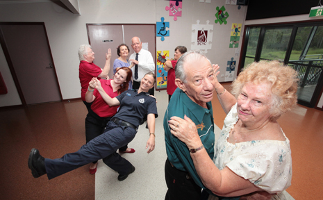 HAVING A BALL: Kieth Connors and Veronica Russo-Connors getting ready for a senior's disco at the Crestmead Community hall.