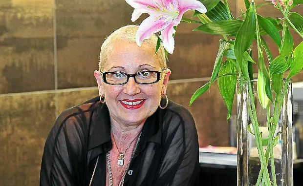 Kim Bonaci is back at her Sunshine Beach studio after cancer treatment and wants to help others going through chemo-induced hair loss.