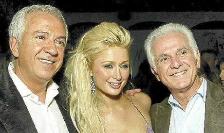 FRIENDS IN HIGH PLACES: Fashion designers Paul Marciano, left, and Maurice Marciano with Paris Hilton.