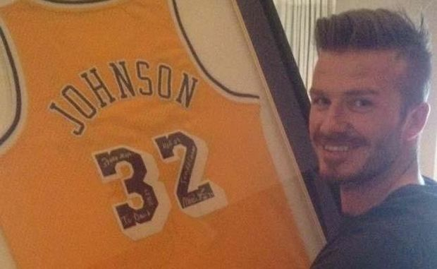 David Beckham with the signed jersey he received for his birthday.