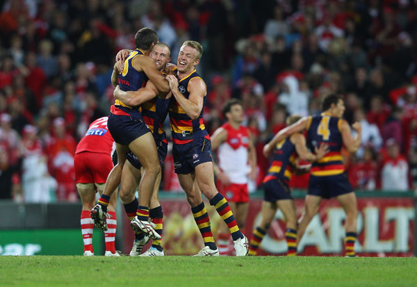 The Adelaide Crows players celebrate victory during the round six AFL match between the Sydney Swans and the Adelaide Crows at the Sydney Cricket Ground