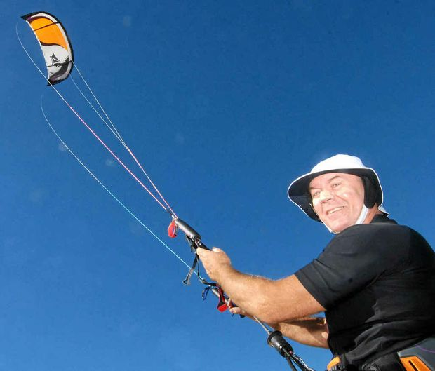 Kite surfer Craig Hawkins launches a kite into the flawless autumn sky over Town Beach yesterday.