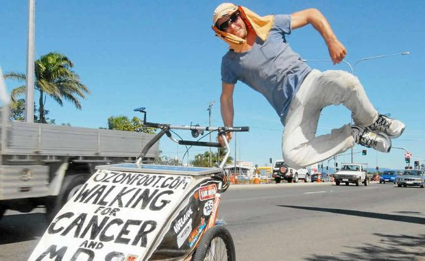 Andrew Cadigan kicks up his heels after walking into Mackay. The cancer and leukaemia fundraiser has less than 2000km to go before completing his round-Australia walk.
