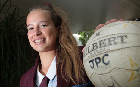 BIG SMILE: Steph Gillies, 16 from John Paul College has recently returned from New Zealand for netball.