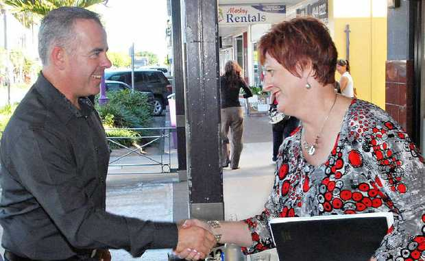 Justin Englert and Deirdre Comerford meet for a chat as counting in the Mackay Regional Council mayoral contest drew to a close yesterday.