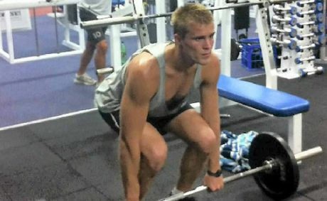 TRAINING HARD: Eugene Bradshaw sticks to a strict training program to further his rowing career.
