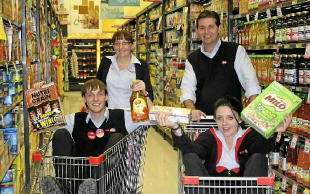 GROCERY GRAB: Supa IGA Warwick Smith family managing partners (back) Tracy, Shane, (front) Andrew and Jess are excited to give back to the community with their first grocery grab.