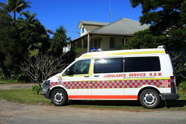 An ambulance on the scene of a crash near Tumbulgum on Tweed Valley Way.