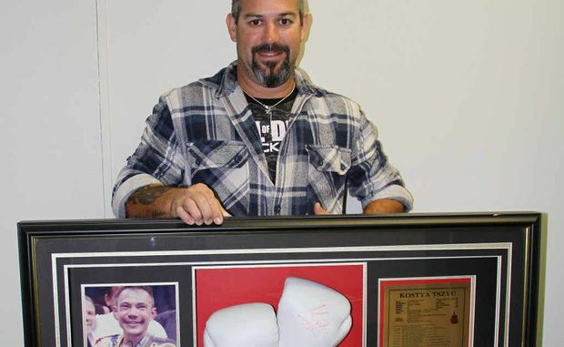 Dave Barnes is selling his brother's signed Kostya Tzu glove to raise money to help families affected by cancer.