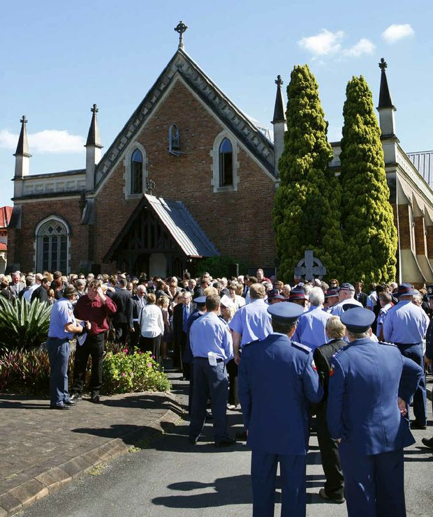 Mourners gather outside St Paul's Anglican Church.