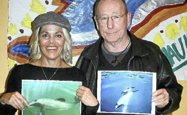 PICTURE THIS: Dove Joans and Tony Barry drum up support for the Maui dolphin visual petition at the Dendy. Photo: DIGBY HILDRETH