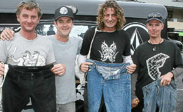 SMILES: Volcom marketing manager Joel Spillane (second, left) with Alan Marshall (left), David May and Michael Crowther, who received a free pair of jeans thanks to the Volcom Give Jeans A Chance event held in Byron Bay last Friday. Photo: Jann Burmester