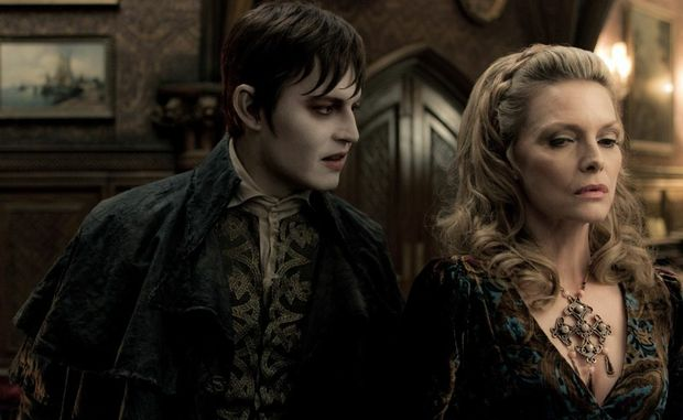 Johnny Depp and Michelle Pfeiffer in a scene from the movie Dark Shadows.