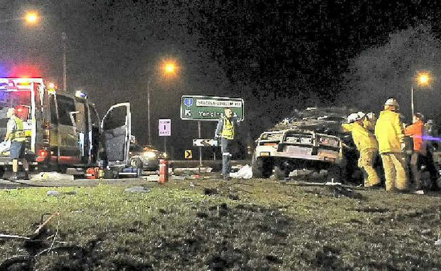 Two died in a roll-over at the Coolum roundabout on the Sunshine Coast Motorway.