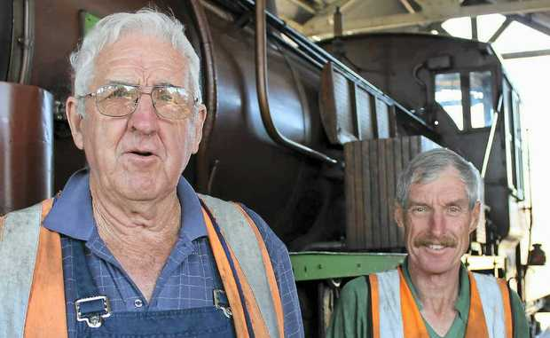 Southern Downs Steam Railway president John Brady (left) and volunteer Ed Diery, pictured next to the much-loved C17 loco which runs to Clifton on Sunday.