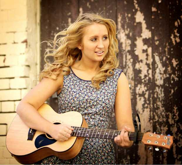 Yeppoon singer Emily Brown, 16, in her 'lucky dress' has released a single, Skyscraper, that is quickly climbing up the iTunes charts.