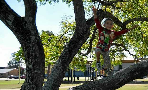 John Samuels, 6, enjoys the cool change in weather.